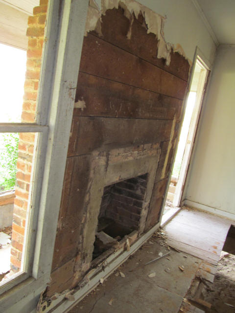 old brick fireplace and rough-sawn walls