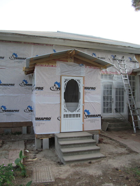 Moisture and air barrier installed to house