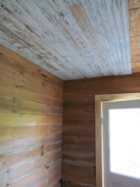 Installing the shiplap and beadboard in the mudroom