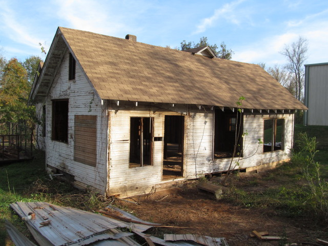 windows and tin shed removed from back of house
