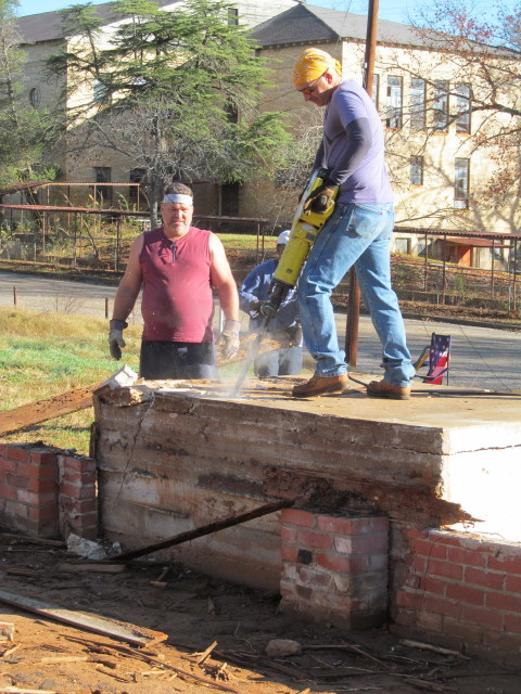 jackhammering the concrete porch