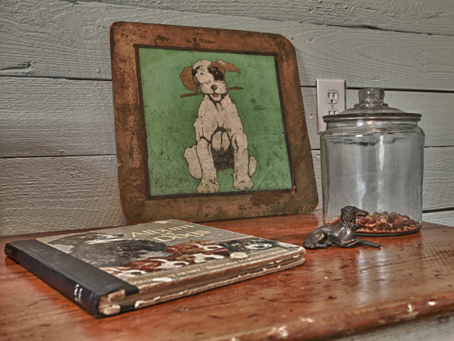 Living Vintage - display of dog treats and dog collectibles in mudroom