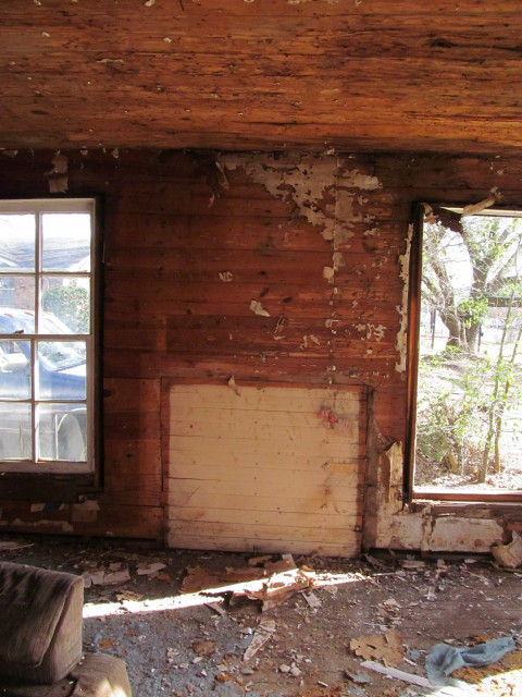 walls reveal evidence of an old fireplace