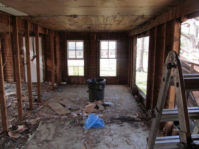 lumber stripped from interior walls