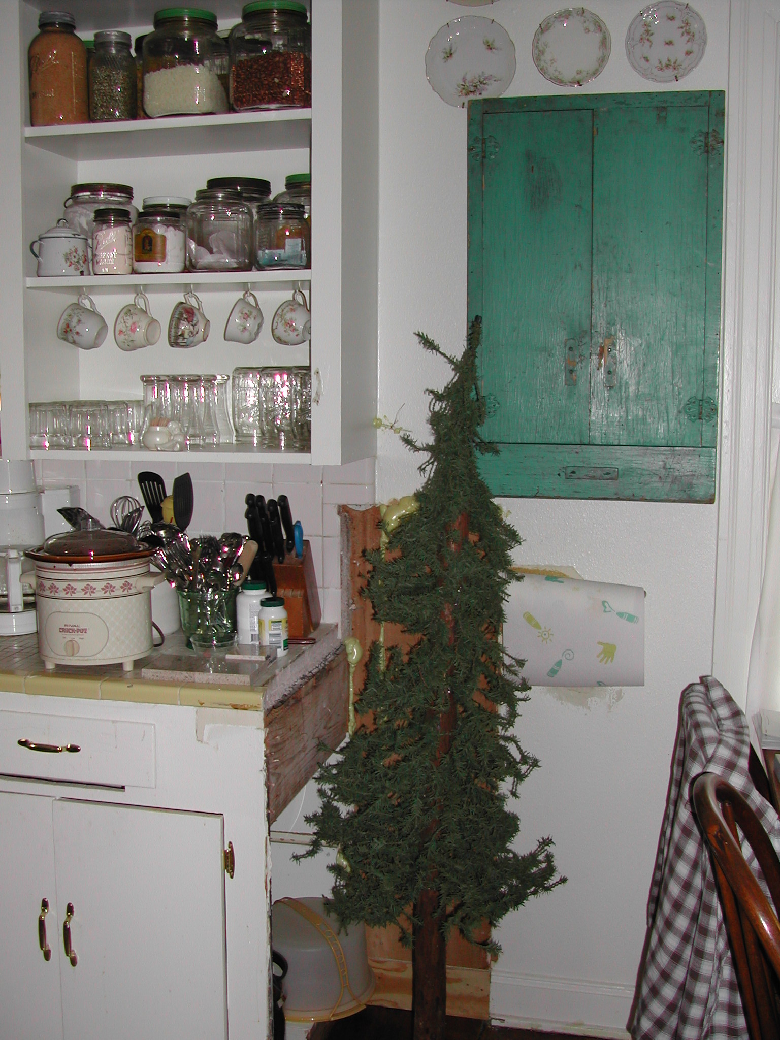 Ruth Avenue kitchen - before - Charlie Brown tree hiding terrible patch job