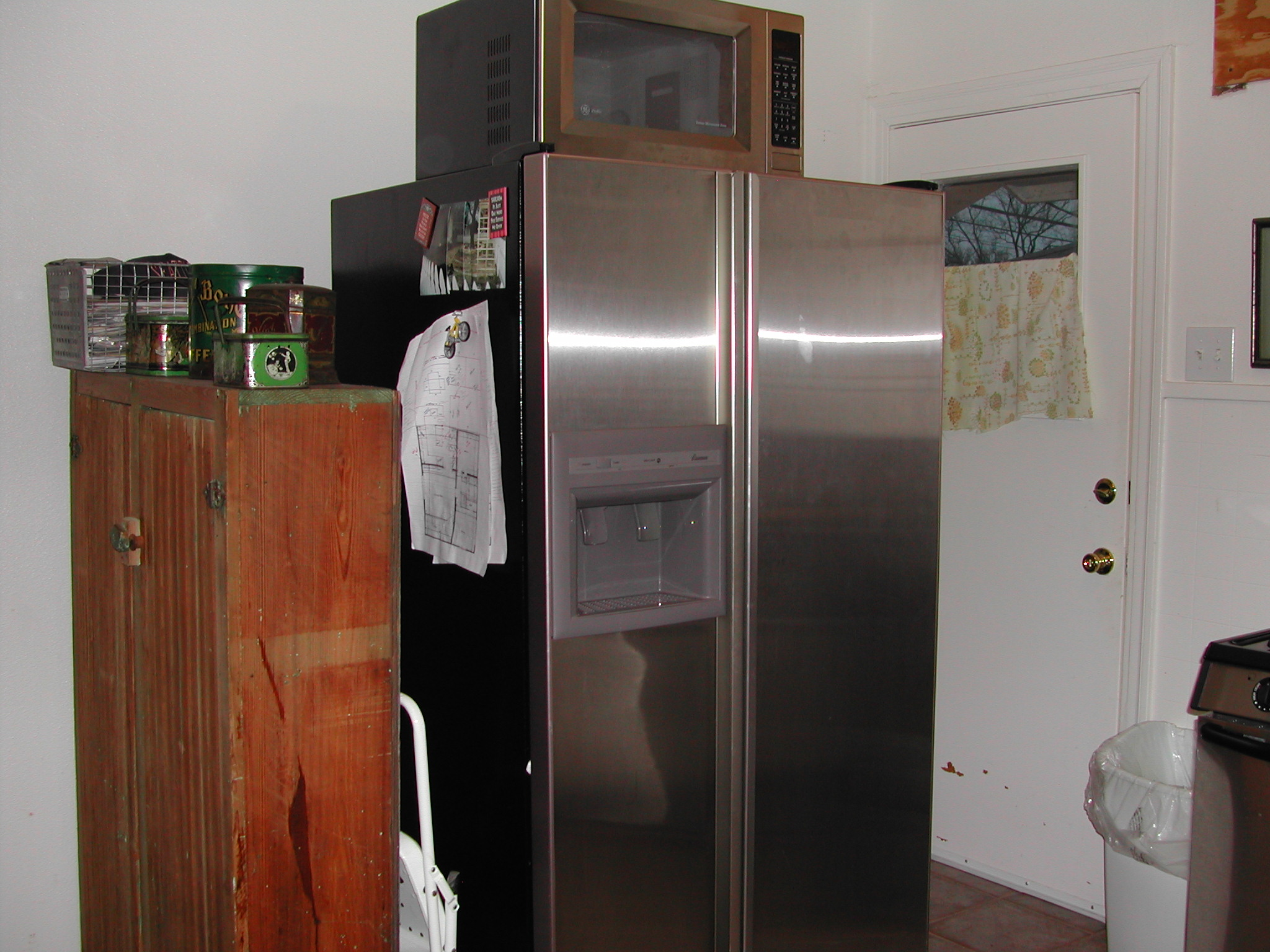 Ruth Avenue kitchen - before - door in the corner and an old cabinet for a pantry