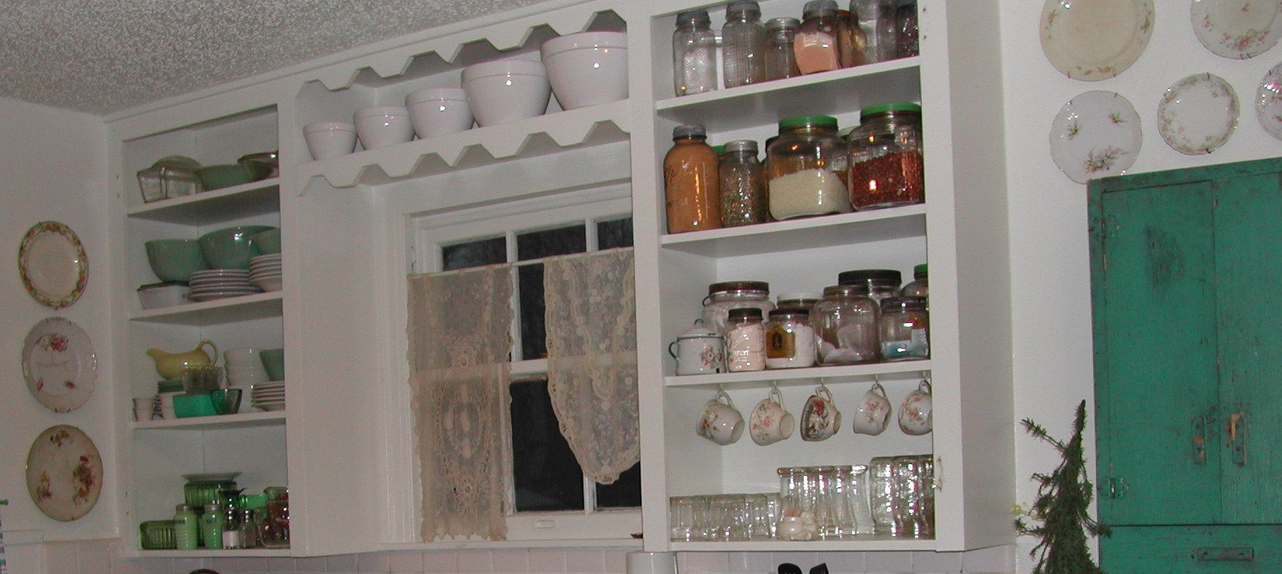 decorative jars, teacups, and plates in old kitchen