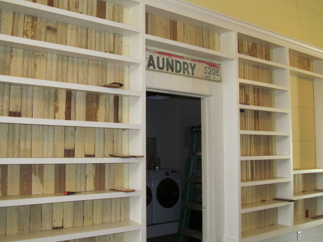 our bookshelves flank the entrance to the laundry room