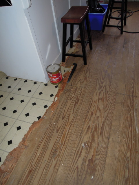 removal of old lineoleum reveals old hardwood floors