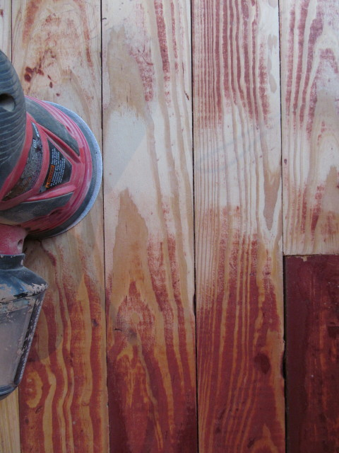removing the stubborn red paint from the patched floors_1