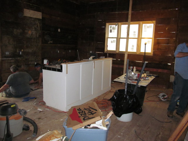 repairing the subfloors, floors, and doing electrical work