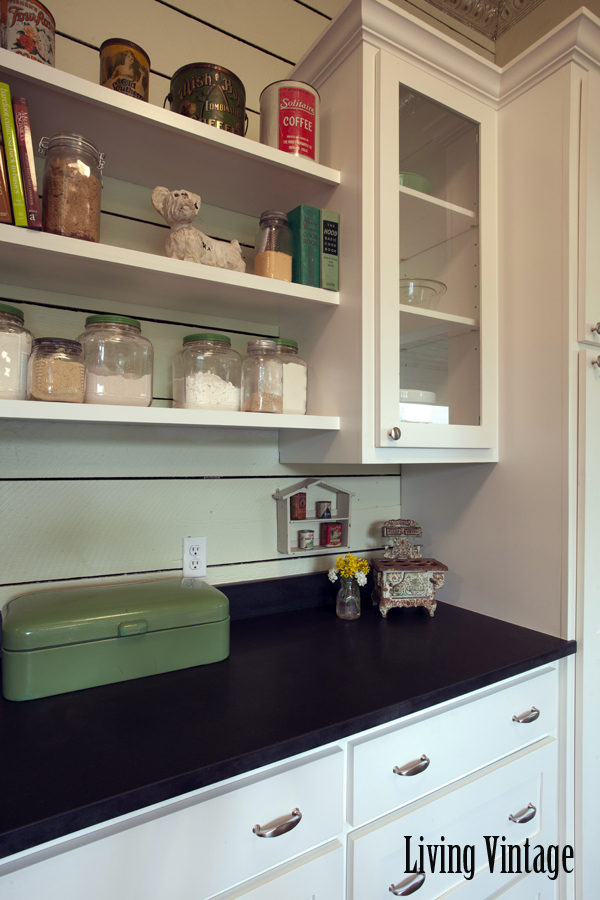 Living Vintage kitchen reveal - open shelving, old jars, recipe books, and kitchen collectibles
