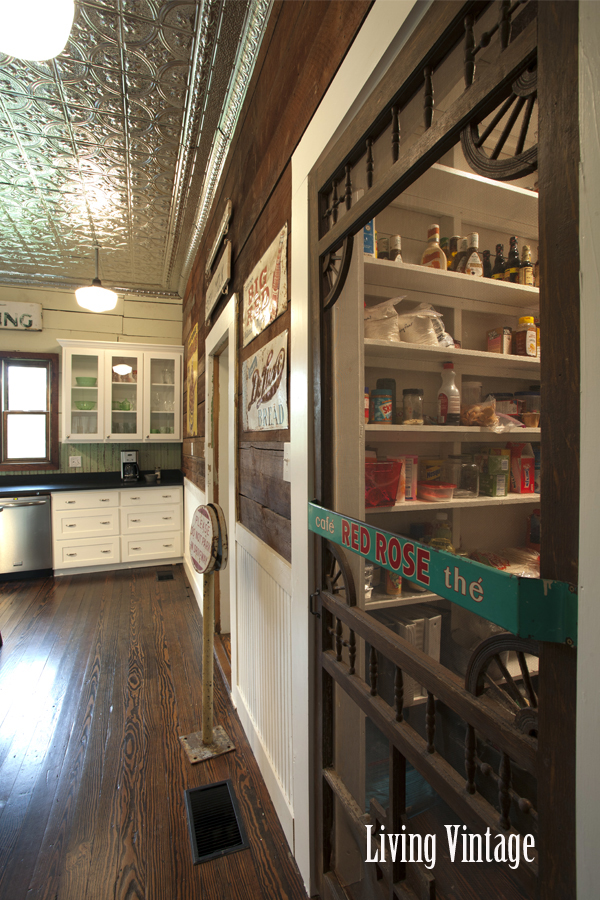 Living Vintage kitchen reveal - walk-in pantry with reclaimed screen door and old push pull sign