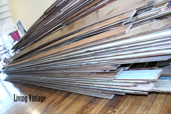 Living Vintage - pile of old beadboard in our dogtrot breezeway