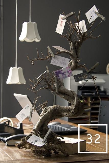 a business card holder using a tree branch