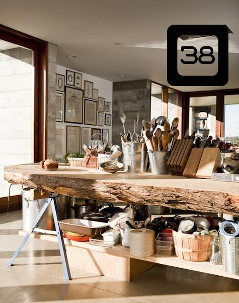 a kitchen island using sawhorses and a slab of wood cut from a large stump
