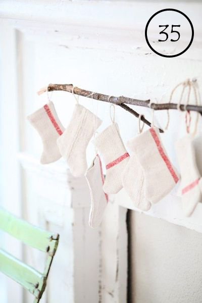 use a small branch to hang stockings above a mantel