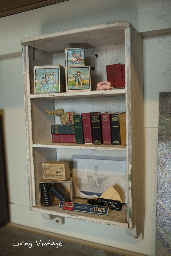 a little cabinet we saved from an old house we salvaged and some miniatures I collect - Living Vintage