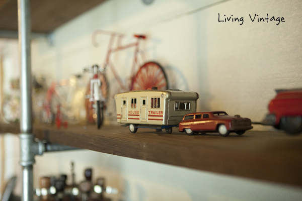 closeup of collectibles on my husband's office shelves - Living Vintage