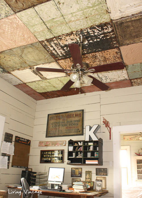 a gorgeous ceiling clad in a mosaic of antique ceiling tins @ Living Vintage