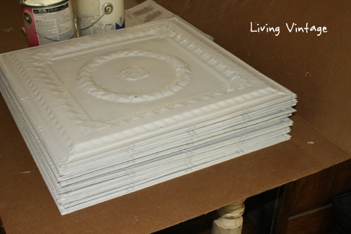 a stack of white ceiling tins - Living Vintage