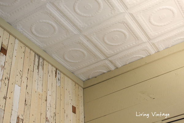 a view of our tin ceilings, our accent wall and painted wood plank walls - Living Vintage