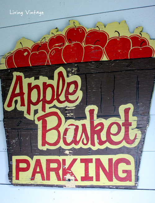 an old apple basket sign displayed in our renovated living room - click on over to see the full reveal!- Living Vintage