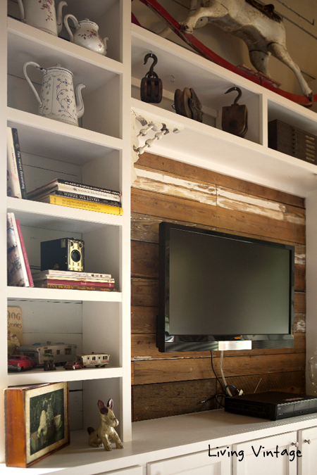 old corbels decorate the entertainment center - click on over to see the full reveal!  Living Vintage