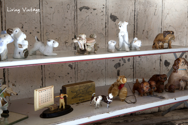 closeup of antique dog collectibles - head on over to see our living room reveal!