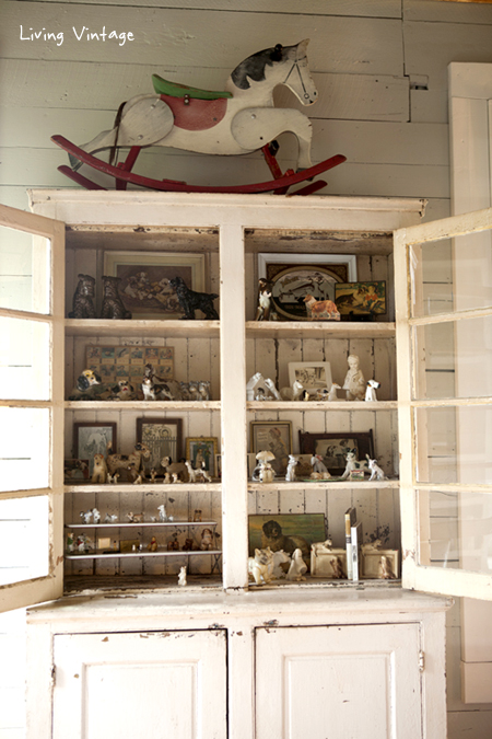 the cabinet where my dog collectibles are displayed -- head on over to see our living room reveal - Living Vintage