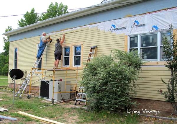 Mark and Mike installing new siding and trim
