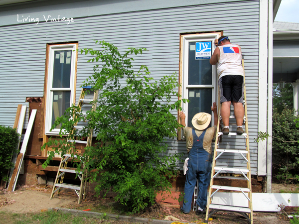 Mark and Mike replacing windows on the first side of our home