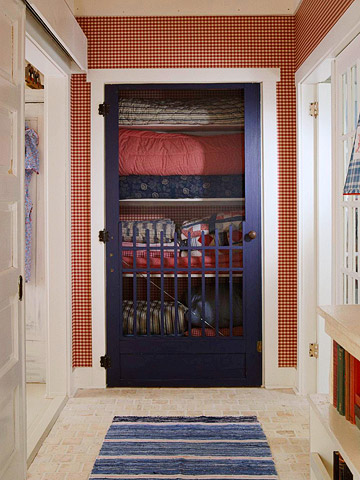 a linen closet with a screen door - featured on Living Vintage's Friday Favorites