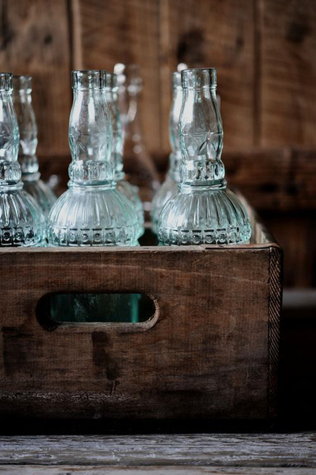 fragile bottles displayed in an old crate - Friday Favorites - Living Vintage