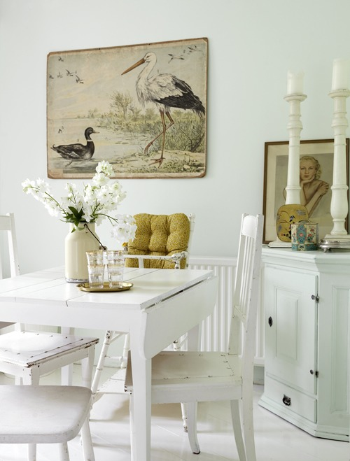an (almost) stark white dining room with a fabulous illustration - one of 8 picks for this week's Friday Favorites - Living Vintage