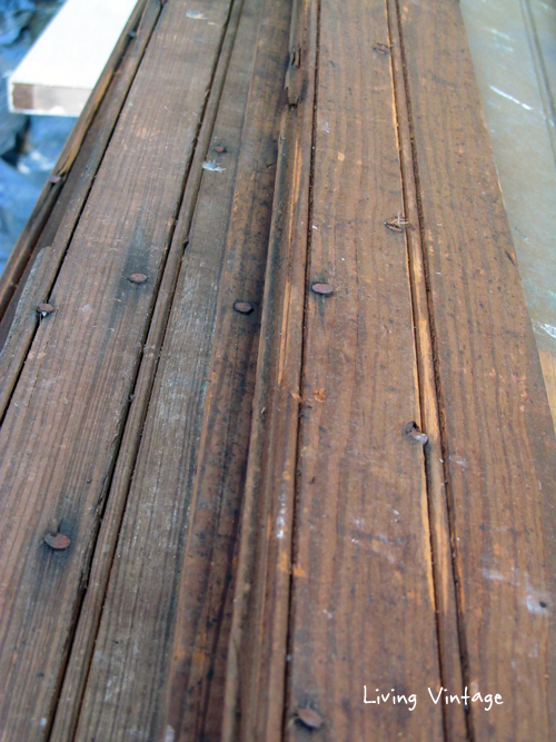 closeup of old brown beadboard