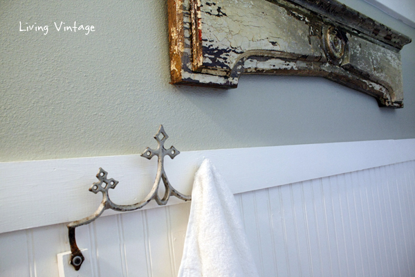 A reclaimed metal roof ornament, now a towel hook