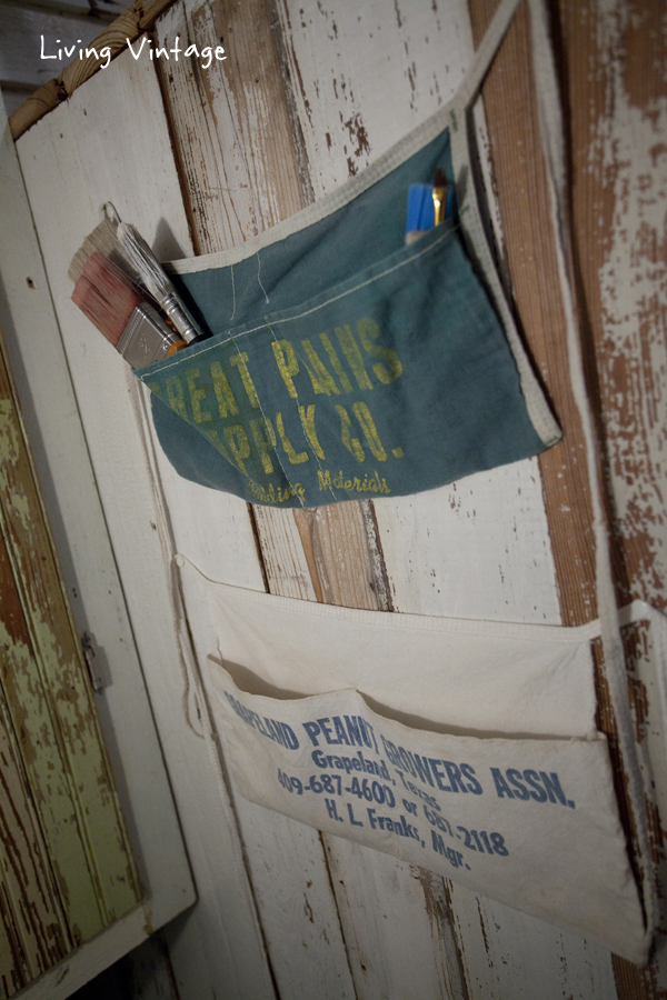 fun vintage carpentry aprons displayed in a fun, vintage laundry room