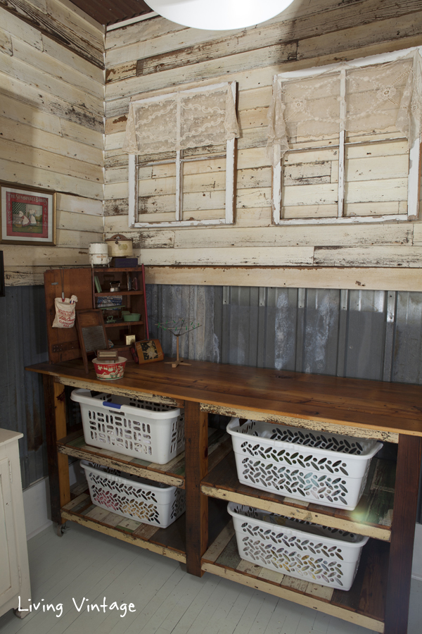reclaimed siding and tin on the walls and reclaimed wood for the laundry sorter!