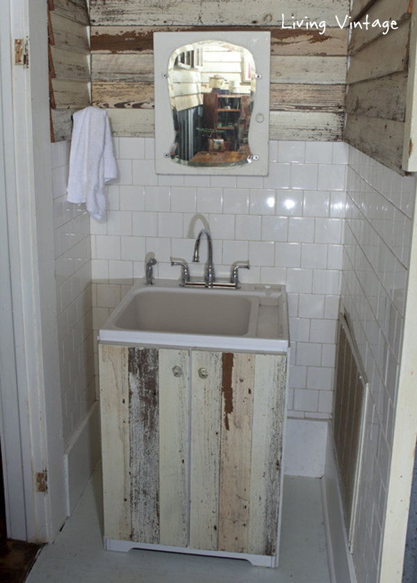a cheap laundry sink clad in reclaimed siding