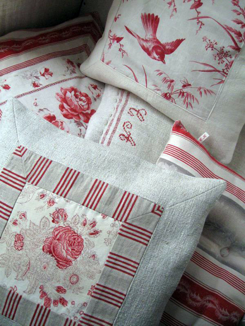 pillows made with an assortment of antique linen pieces