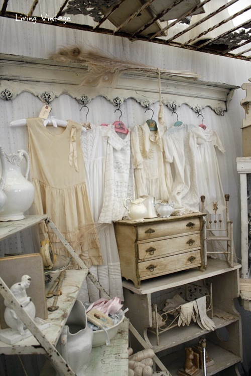 a collection of white, vintage clothing