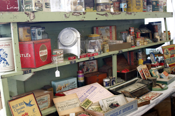 a fun green shelf and a display of vintage advertising and other smalls