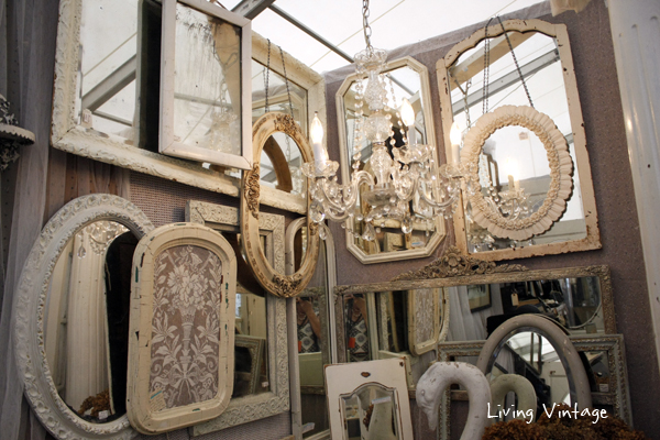 a large collection of beautiful antique mirrors