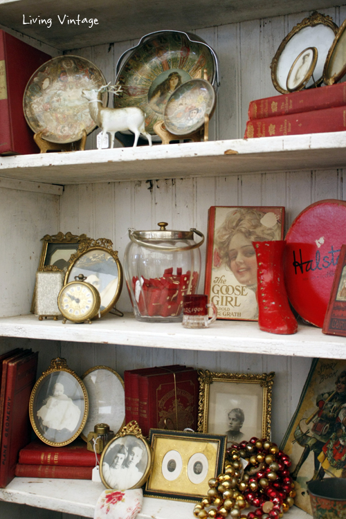 an arrangement of red and gold antiques