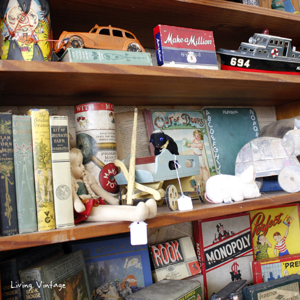 (cropped) a wide assortment of children's toys and books in Two Sisters Antiques booth
