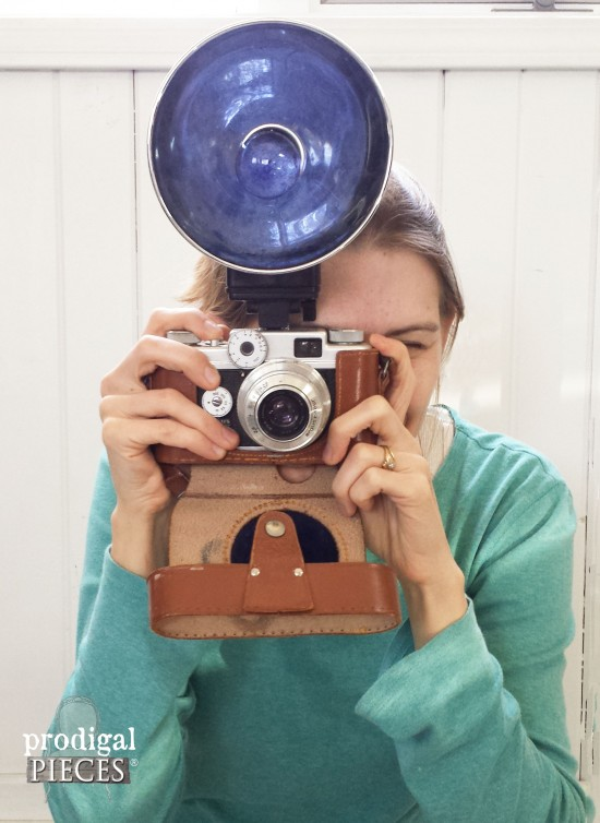 Larissa and a vintage camera she scored.