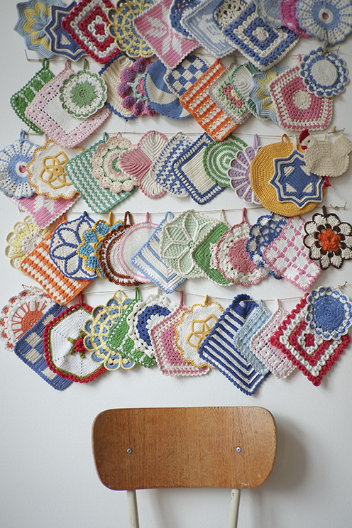 a fun and well-displayed collection of crocheted potholders - one of 8 picks for this week's Friday Favorites