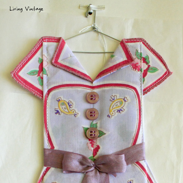 the detail of an adorable miniature dress made with a vintage hanky! --- Living Vintage