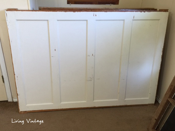 Old doors for sale -- they were mounted on a wall and hinged at the top!